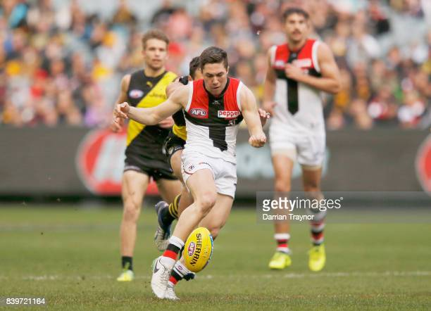 Jade Gresham of the Saints kicks a goal during the round 23 AFL match between the Richmond Tigers and the St Kilda Saints at Melbourne Cricket Ground...