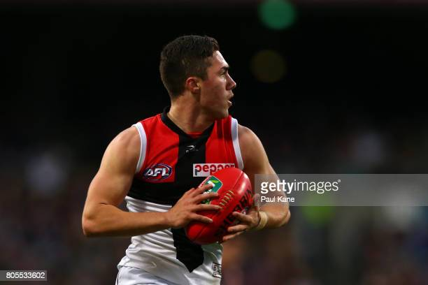 Jade Gresham of the Saints looks to pass the ball during the round 15 AFL match between the Fremantle Dockers and the St Kilda Saints at Domain...