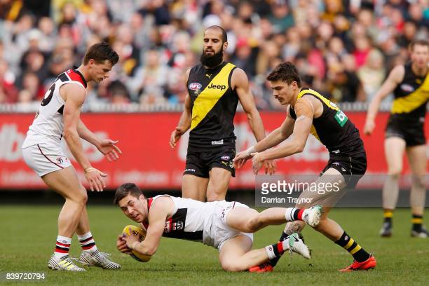 Jade Gresham of the Saints marks the ball during the round 23 AFL match between the Richmond Tigers and the St Kilda Saints at Melbourne Cricket...