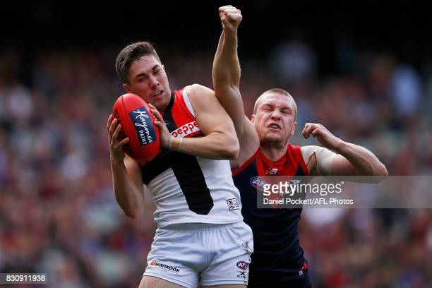 Jade Gresham of the Saints marks the ball under pressure from Tom McDonald of the Demons during the round 21 AFL match between the Melbourne Demons...