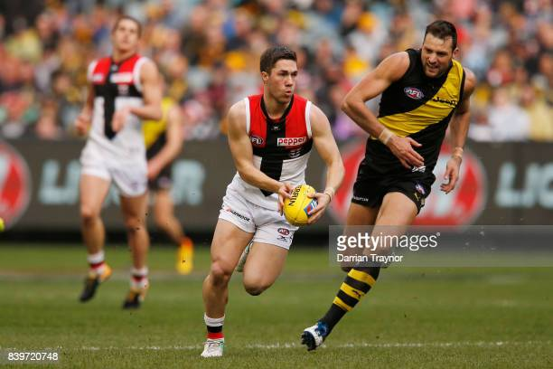 Jade Gresham of the Saints runs with the ball during the round 23 AFL match between the Richmond Tigers and the St Kilda Saints at Melbourne Cricket...