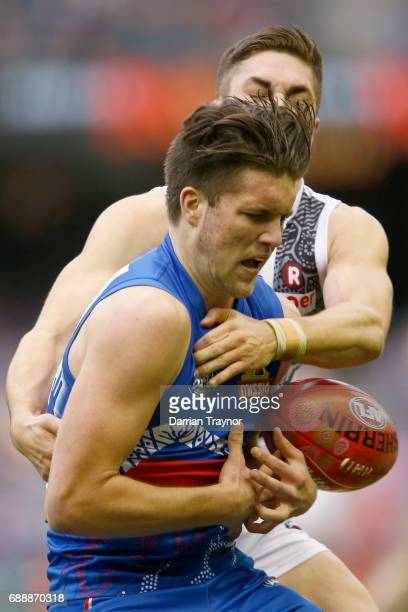 Jade Gresham of the Saints tackles Bailey Williams of the Bulldogs during the round 10 AFL match between the Western Bulldogs and the St Kilda Saints...