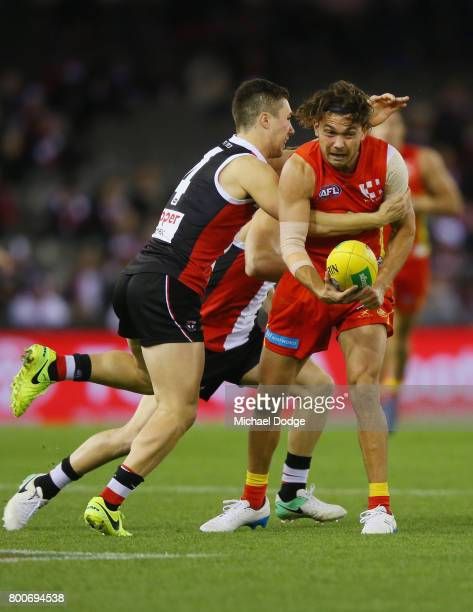Jade Gresham of the Saints tackles Jarrod Harbrow during the round 14 AFL match between the St Kilda Saints and the Gold Coast Suns at Etihad Stadium...