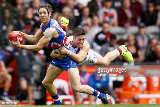 Jade Gresham of the Saints tackles Robert Murphy of the Bulldogs during the round 10 AFL match between the Western Bulldogs and the St Kilda Saints...