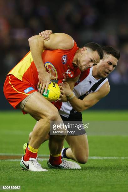 Jade Gresham of the Saints tackles Steven May of the Suns during the round 14 AFL match between the St Kilda Saints and the Gold Coast Suns at Etihad...
