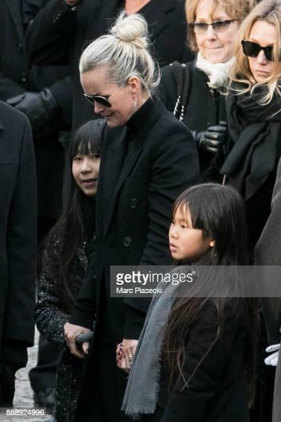 Jade Hallyday Laeticia Hallyday and Joy Hallyday are seen during Johnny Hallyday's funerals at Eglise De La Madeleine on December 9 2017 in Paris...