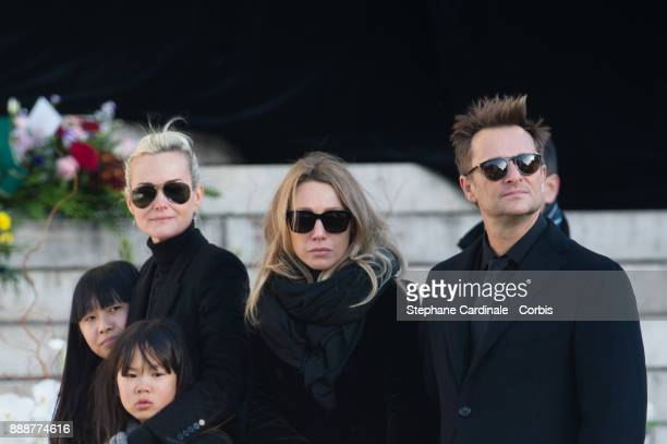 Jade Hallyday, Laetitia Hallyday, Joy Hallyday, Laura Smet and David Hallyday during Johnny Hallyday's Funeral Procession at Eglise De La Madeleine...