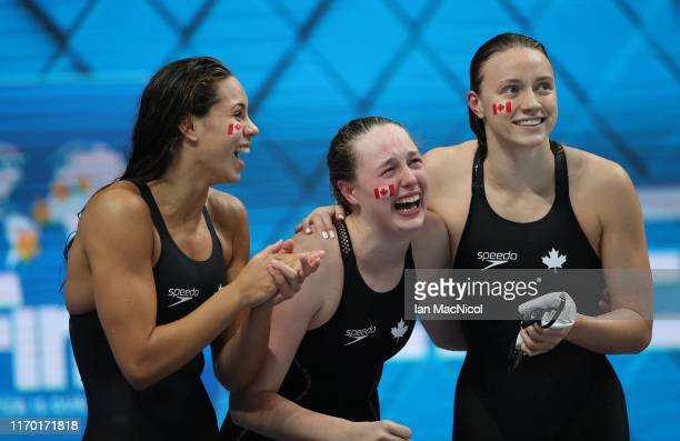 Jade Hannah Avery Wiseman and Hanna Henderson of Canada react during the Women's 4 x 100m Medley Relay during day six of the FINA Junior Swimming...