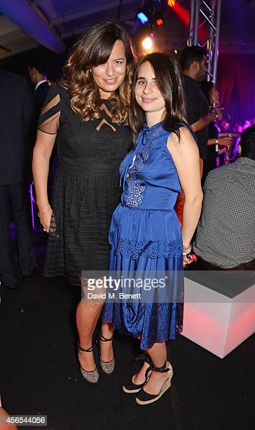 Jade Jagger and Assisi Jackson attend the 10th anniversary of Mortons in Berkeley Square Gardens on October 2 2014 in London England