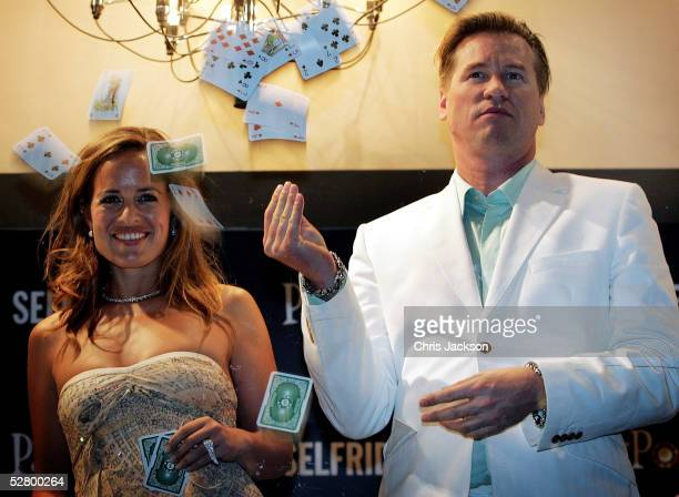 Jade Jagger and Val Kilmer pose at midnight in Selfridges' window during a party at the Selfridges Oxford Street on May 11 2005 in London England The...