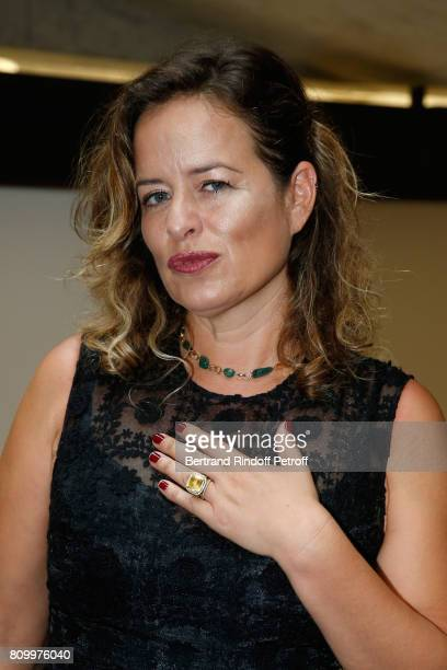Jade Jagger poses with jewels of her creation during the Don't Take it Personally by Jade Jagger JeanBaptiste Pauchard Exhibition Party on July 6...