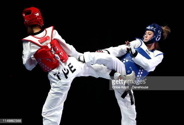 Jade Jones of Great Britain and Chia Ling Lo of Taiwan during their round 16 match of the Women's 57kg division at The World Taekwondo Championships...