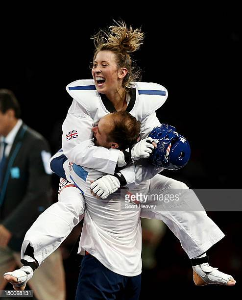 Jade Jones of Great Britain and her coach celebrate Jones defeating Yuzhuo Hou of China during the Women's 57kg Taekwondo gold medal final on Day 13...