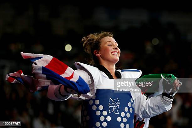 Jade Jones of Great Britain celebrates defeating Yuzhuo Hou of China during the Women's -57kg Taekwondo gold medal final on Day 13 of the London 2012...