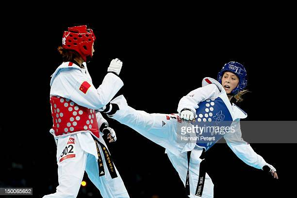 Jade Jones of Great Britain competes against Yuzhuo Hou of China during the Women's 57kg Taekwondo gold medal final on Day 13 of the London 2012...
