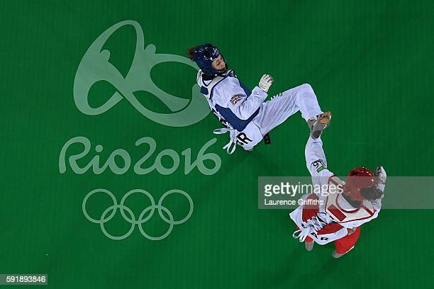 Jade Jones of Great Britain on her way to beating Naima Bakka of Morocco during the Women's Taekwondo 57kg at the Carioca Arena on Day 13 of the 2016...