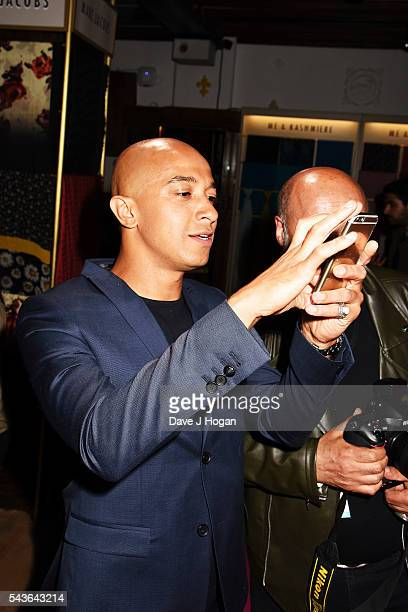 """Jade Jones takes a photo of Emma Bunton during the after party of the world premiere of """"Absolutely Fabulous: The Movie"""" at Liberty on June 29, 2016..."""