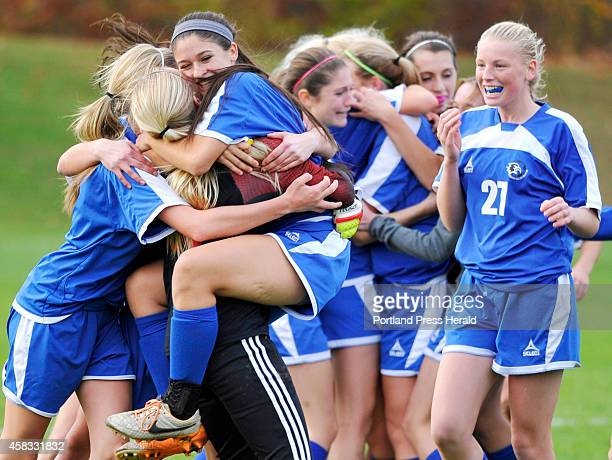 Jade Jordan jumps into the arms of goalie Madison Day as other team members rejoice after time ran out on a 1-0 win for Sacopee Valley as Waynflete...