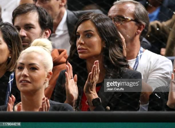 Jade Lagardere wife of Arnaud Lagardere cheers for Benoit Paire of France during his second round match against Gael Monfils of France at the Rolex...