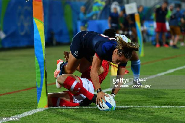 Jade le Pesq of France holds off Ghislaine Landry of Canada to score a try during the Women's Rugby Sevens Quarter Final match between Canada and...