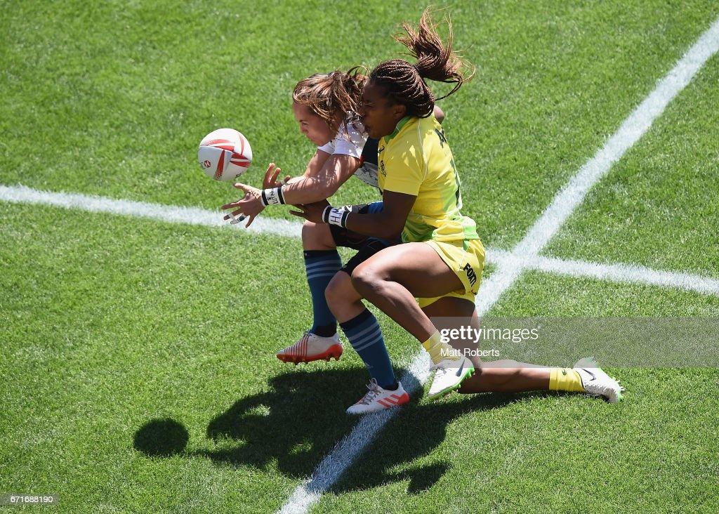 Jade Le Pesq of France is tackled by Ellia Green of Australia during the HSBC World Rugby Women's Sevens Series 2016/17 Kitakyushu quarter final between Australia and France at Kitakyushu Stadium on April 23, 2017 in Kitakyushu, Japan.