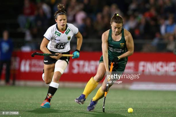Jade Mayne of South Africa attempts to get away from Charlotte Stapenhorst of Germany during the Quarter Final match between Germany and South Africa...