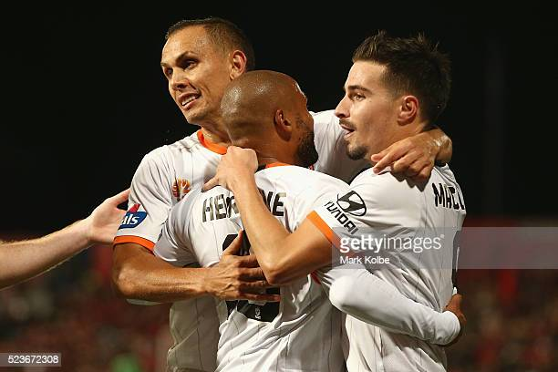 Jade North and Henrique of the Roar celebrate with Jamie MaClaren of the Roar after he scored a goal during the ALeague Semi Final match between the...