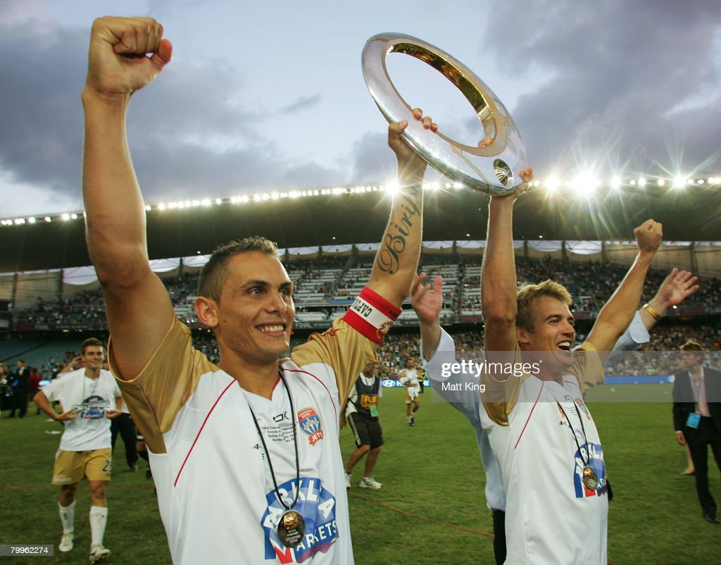 Jade North and Joel Griffiths of the Jets hold up the A-League trophy after victory in the A-League Grand Final match between the Central Coast Mariners and the Newcastle Jets at the Sydney Football Stadium on February 24, 2008 in Sydney, Australia.