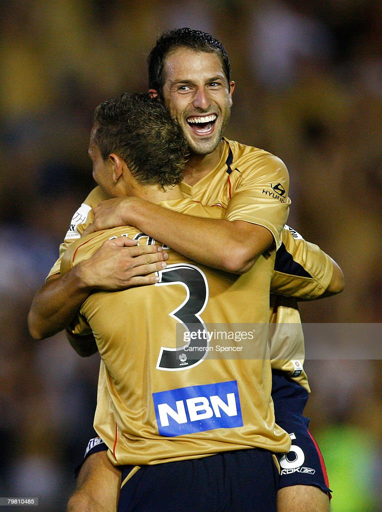 Jade North of the Jets celebrates with teammate Andrew Durante after winning the A-League Preliminary Final match between the Newcastle Jets and the Queensland Roar at EnergyAustralia Stadium on February 17, 2008 in Newcastle, Australia.