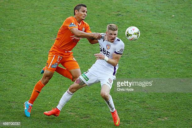 Jade North of the Roar and Andrew Keogh of the Glory compete for the ball during the round eight ALeague match between Brisbane Roar and Perth Glory...