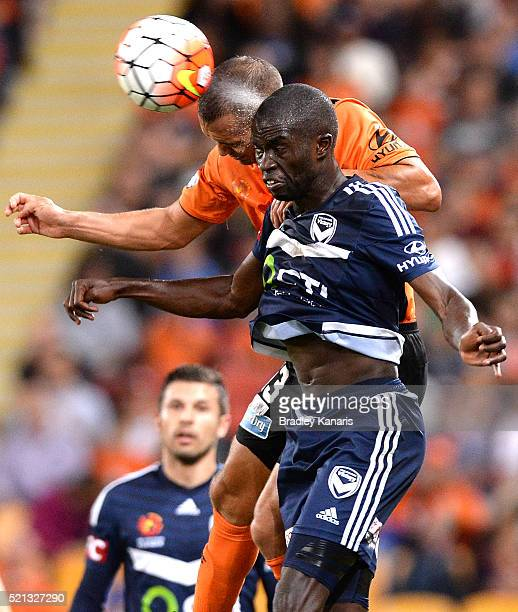 Jade North of the Roar and Jason Geria of the Victory challenge for the ball during the ALeague Elimination Final match between the Brisbane Roar and...