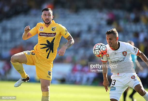 Jade North of the Roar contests the ball with Roy O'Donovan of the Mariners during the round 11 ALeague match between the Central Coast Mariners and...
