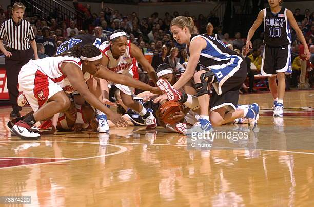 Jade Perry Laura Harper Sa'de WileyGatewood and Ashleigh Newman of the Maryland Terrapins and Brittany Mitch of the Duke Blue Devils go after a loose...