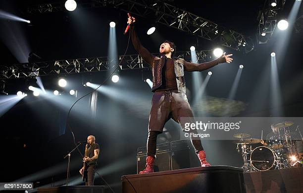 Jade Puget and Davey Havok of AFI perform onstage at 1067 KROQ Almost Acoustic Christmas 2016 Night 1 at The Forum on December 10 2016 in Inglewood...
