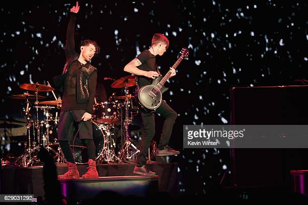 Jade Puget right and Davey Havok of the band AFI perform onstage at 1067 KROQ Almost Acoustic Christmas 2016 Night 1 at The Forum on December 10 2016...