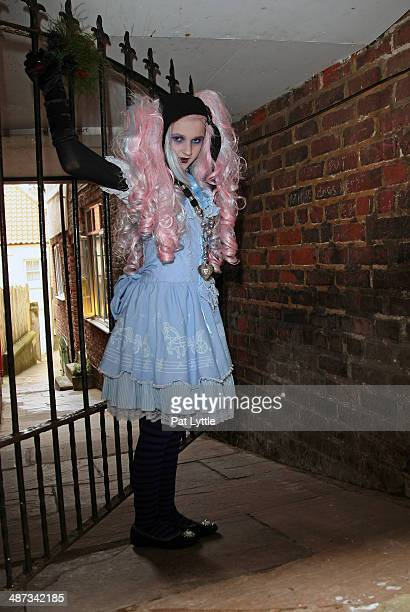 Jade Shaw from Bournemouth poses for a picture wearing a blue and white Japanese Lolita dress striped socks and black shoes with an eye ball on a...