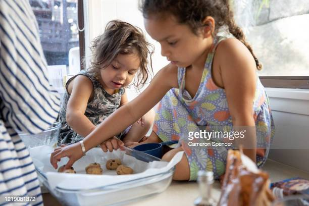 Jade Spencer and Sienna Spencer, daughters of photographer Cameron Spencer, help bake some cookies at home on April 5, 2020 in Sydney, Australia....