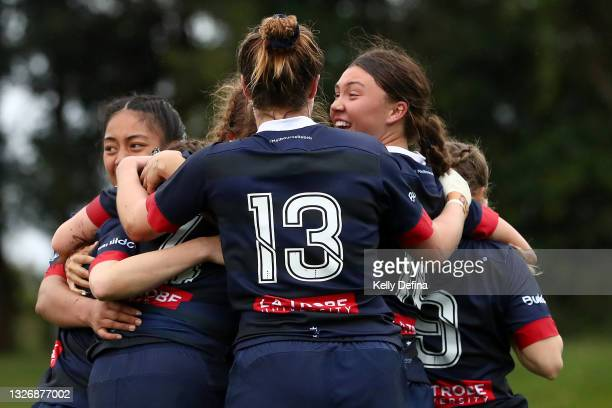 Jade Te Aute of the Rebels and team mates celebrate during the Super W match between the Melbourne Rebels and the ACT Brumbies at Coffs Harbour...