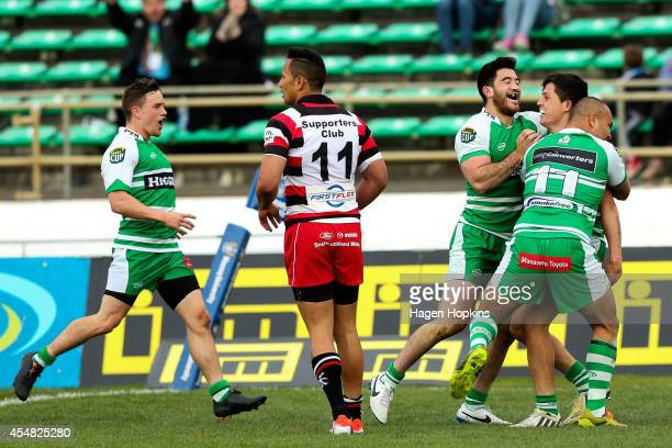 Jade Te Rure is congratulated by Nehe Milner-Skudder and Nathan Tudreu of Manawatu after scoring a try during the ITM Cup match between Manawatu and...