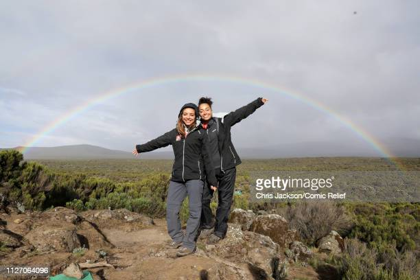 Jade Thirlwall and LeighAnne Pinnock pose by a rainbow on day 2 of 'Kilimanjaro The Return' for Red Nose Day on February 24 2019 in Arusha Tanzania...