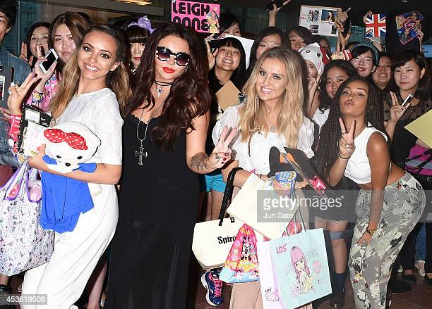 Jade Thirlwall Jesy Nelson Perrie Edwards and LeighAnne Pinnock of Little Mix is seen upon arrival at Haneda Airport on August 15 2014 in Tokyo Japan