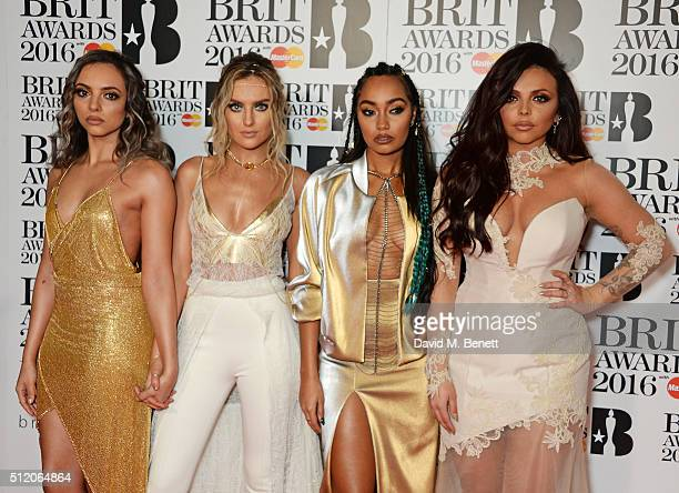 Jade Thirlwall Perrie Edwards LeighAnne Pinnock and Jesy Nelson of Little Mix arrive at the BRIT Awards 2016 at The O2 Arena on February 24 2016 in...