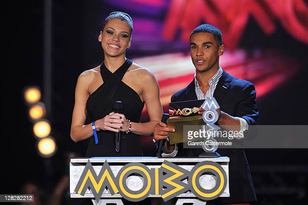 Jade Thompson and Lucien Laviscourt present the Best RB/Soul Act on stage during the MOBO Awards 2011 at the SECC on October 5 2011 in Glasgow...