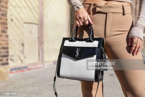 Jade Tuncdoruk wearing a YSL handbag at MercedesBenz Fashion Week Resort 20 Collections on May 14 2019 in Sydney Australia