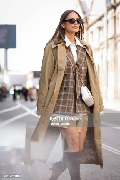 Jade Tuncdoruk wearing Mossman trench coat, Oroton blazer, Camilla and Marc shirt, Dior bag, Bec and Bride skirt and Dear Frances boots at Afterpay...