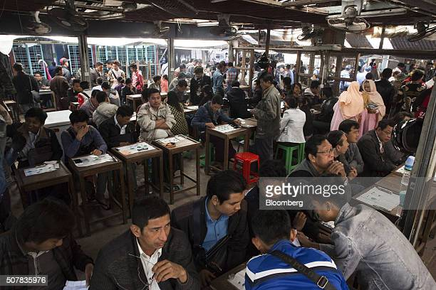 Jade vendors sit at small tables with customers at the Mandalay Jade Market in Mandalay Myanmar on Saturday Jan 30 2016 As Aung San Suu Kyi's party...