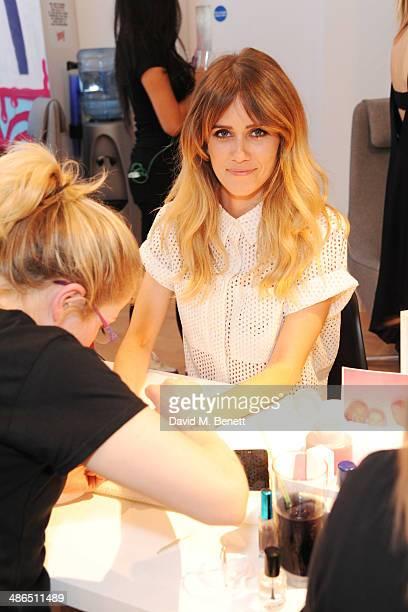 Jade Williams aka Sunday Girl enjoys a manicure at the Beats by Dr Dre Drenched in Colour nail event on April 24 2014 in London England
