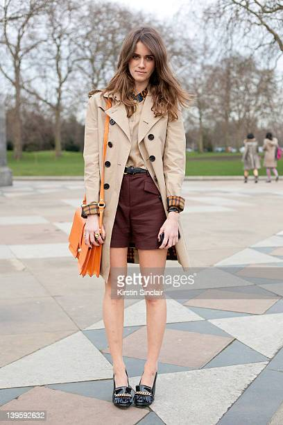 Jade Williams Aka Sunday Girl wearing Topshop shoes Burberry Trench Coat and shirt Mulberry Whistles bag shorts street style at London fashion week...