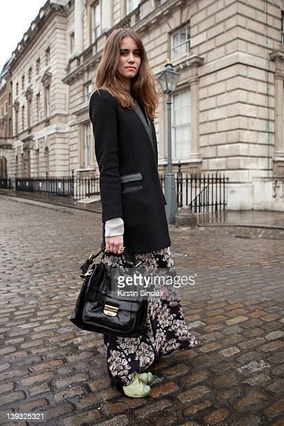 Jade Williams wearing Kinder Dress Kooples jacket Nina Ricci bag street style at London fashion week autumn/winter 2012 womenswear shows on February...