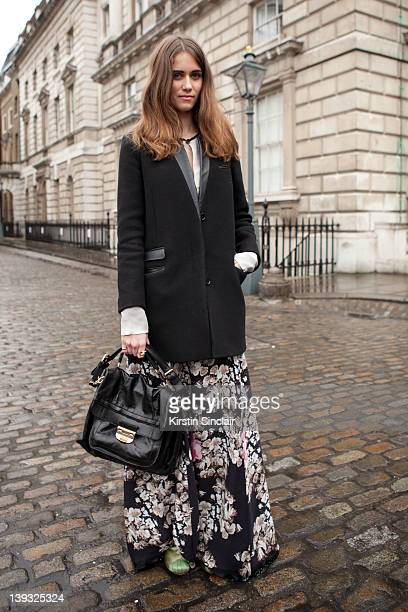 Jade Williams wearing Kinder Dress Kooples jacket Nina Ricci bag street style at London fashion week autumn/winter 2012 womenswear shows on February...